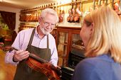 pic of leaving  - Customer Leaving Violin For Repair In Shop - JPG