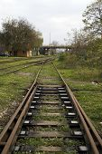 foto of train track  - Crossover to the railway line is the plant that is used to switch trains from track to track - JPG