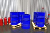 stock photo of wooden pallet  - Metal barrels of fuel on a wooden pallet and fire - JPG