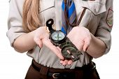 foto of boy scout  - Girl scout holding the compass isolated on white background - JPG