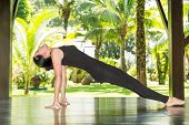 stock photo of pilates  - Young woman is practicing yoga and pilates on nature. Morning meditation at summer