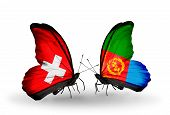 image of eritrea  - Two butterflies with flags on wings as symbol of relations Switzerland and Eritrea - JPG