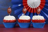 picture of iron star  - Red white and blue theme cupcakes with football toppers for Super Bowl Sunday party or collage football finals and playoffs.