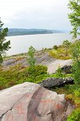 picture of rock carving  - Rock carvings at Alta Norway with fjord on background - JPG