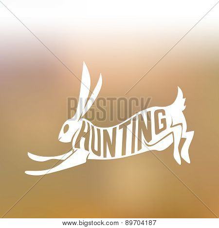 Creative design of running rabbit inside hare silhouette on colorfull blurred background with text h