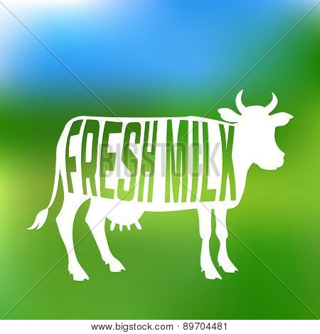 Cow silhouette with text inside about fresh milk. Label or emblem.