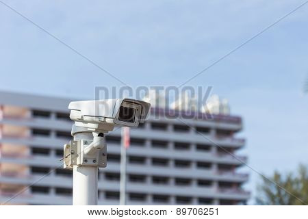 Security Cctv Camera Operating In Front Of Building