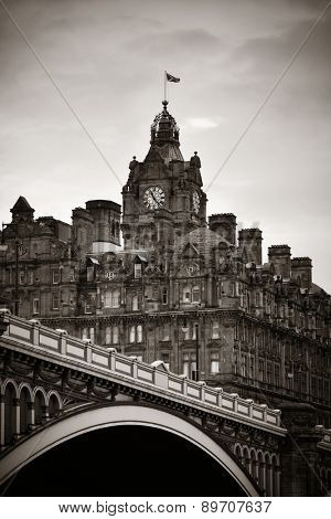 Balmoral Hotel bell tower with bridge and Edinburgh city view.