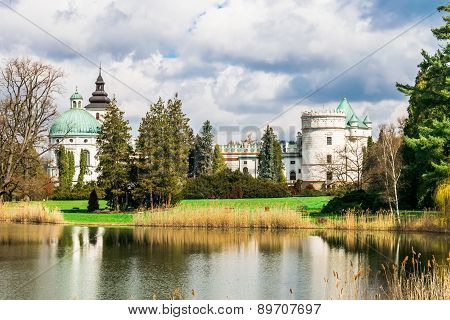 Grand Castle Near The Lake In The Park In Poland, Europe.