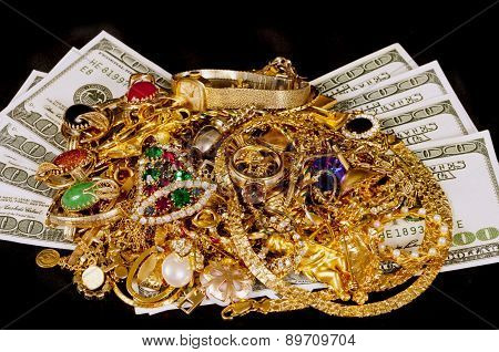 Money Under A Pile Of Gold Jewelry