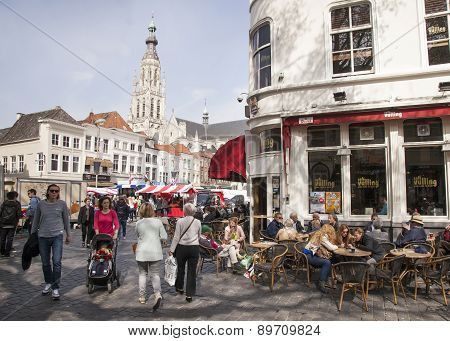 People Enjoying A Drink On The Market Near Breda Cathedral