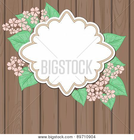 Retro Label With Pink Flowers Over Wood