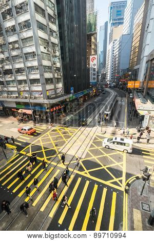 Pedestrians Moving On Zebra Crosswalk At Hong Kong