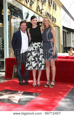 LOS ANGELES - MAY 1:  Michael J. Fox, Julianna Margulies, Tracy Pollan at the Julianna Margulies Hollywood Walk of Fame Star Ceremony at the Hollywood Boulevard on May 1, 2015 in Los Angeles, CA