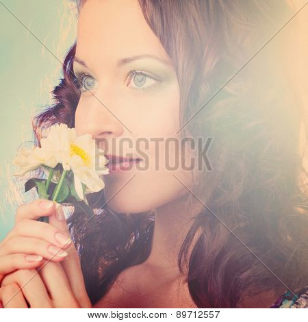 beautiful woman with flower on blue background