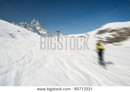 Blurred Motion Skiing In Scenic Alpine Resort