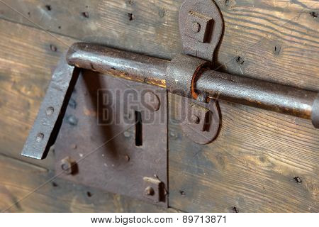 Old Lock With Big Deadbolt To Close The Door Of The Castle