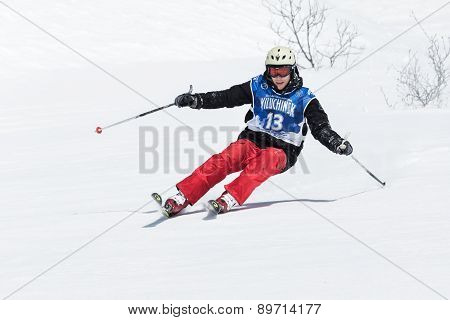 Skier Rides Steep Mountains. Kamchatka Peninsula, Far East, Russia