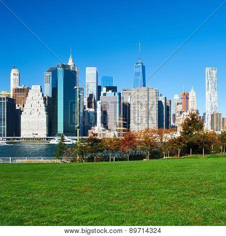 Lower Manhattan skyline view from Brooklyn Bridge Park in New York City