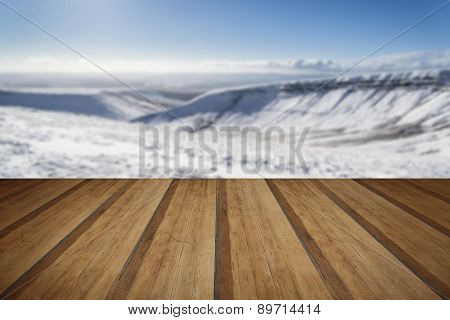 Stunning Blue Sky Mountain Landscape In Winter With Snow Covered Peaks With Wooden Planks Floor