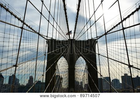 Brooklyn bridge pillar with sun back light, New York City, USA