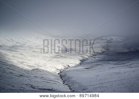 Moody Dramatic Low Cloud Winter Landscape In Mountains With Snow