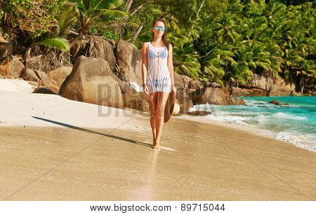Woman in bikini on beach Anse Intendance at Seychelles, Mahe