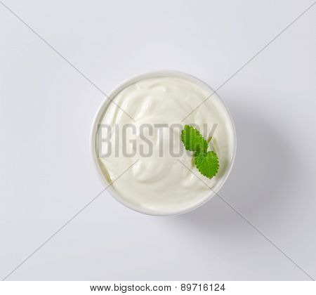 overhead view of fresh sour cream served in the bowl