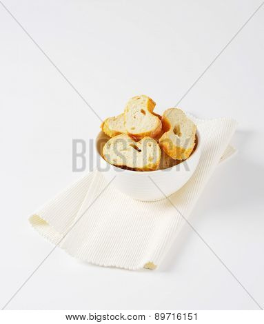 sliced french baguette in the bowl  with napkin