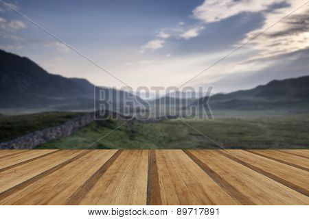 View Along Misty Valley Towards Snowdonia Mountains With Wooden Planks Floor
