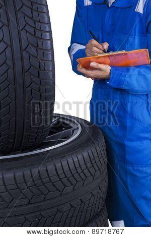Technician Checks Tires Condition