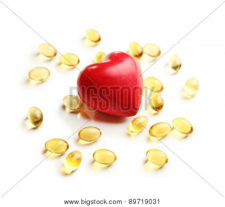 Red heart and cod liver oil, isolated on white