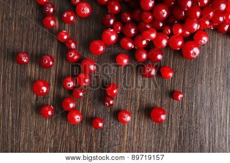 Red cranberries on wooden table, closeup