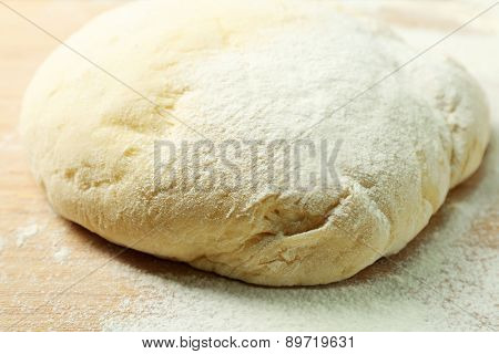 Dough on cutting board close up