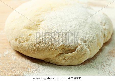 Dough on cutting board close up