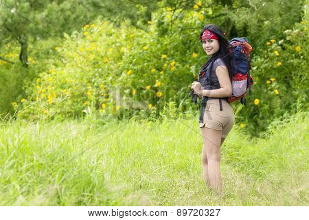 Rear View Of Female Hiker In Nature