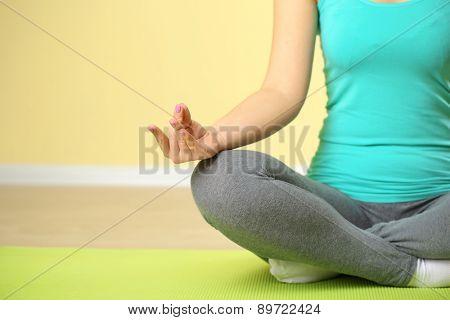 Hand yoga gesture on bright background