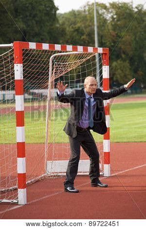 Businessman defending goal