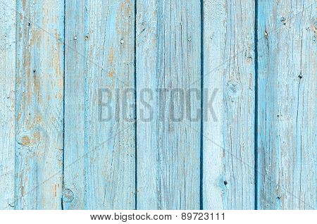 Texture Of Old Wooden Fence With Cracked Blue Paint