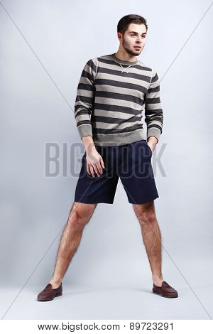 Man in casual style on gray background