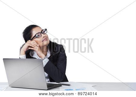 Mixed Race Businesswoman Daydreaming