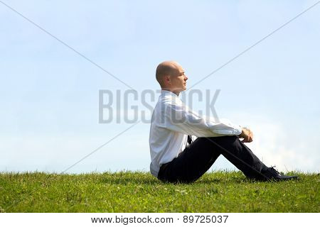 Businessman contemplating in park