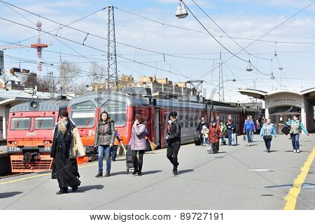 ST. PETERSBURG, RUSSIA - APRIL 27, 2015: People go to the city from the commuter train on the Finlyandskiy Railway station. Russian Railways canceled a lot of commuter trains due to unprofitability