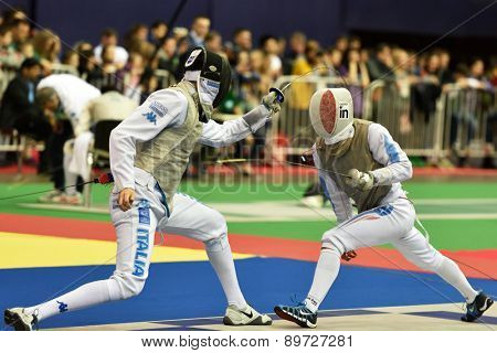 ST. PETERSBURG, RUSSIA - MAY 2, 2015: Andrea Cassara of Italy vs Erwan Le Pechoux of France in the quarterfinal of International fencing tournament St. Petersburg Foil, the stage of FIE World Cup
