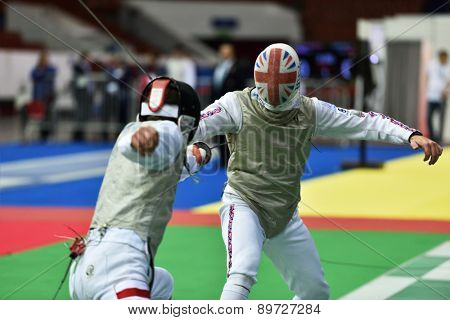 ST. PETERSBURG, RUSSIA - MAY 2, 2015: Michal Janda of Poland vs Laurence Halsted of Great Britain in 1/64 final of International fencing tournament St. Petersburg Foil, the stage of FIE World Cup