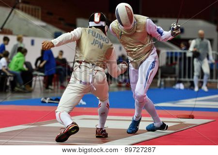 ST. PETERSBURG, RUSSIA - MAY 2, 2015: Daiki Fujino of Japan vs Vincent Simon of France in 1/64 final of International fencing tournament St. Petersburg Foil. The tournament is the stage of World Cup