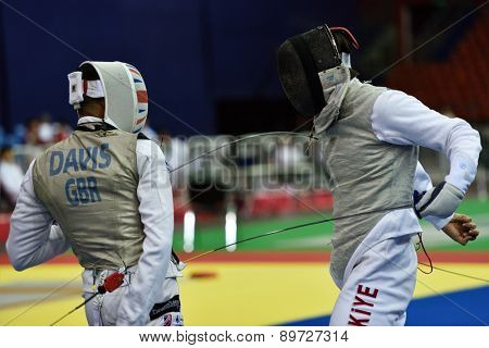 ST. PETERSBURG, RUSSIA - MAY 2, 2015: James-Andrew Davis of Great Britain vs Engin Batuhan Menkuer of Turkey in 1/64 final of International fencing tournament St. Petersburg Foil