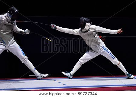 ST. PETERSBURG, RUSSIA - MAY 2, 2015: Andrea Cassara of Italy (left) vs Daniele Garozzo of Italy in semifinal of International fencing tournament St. Petersburg Foil, the stage of FIE World Cup