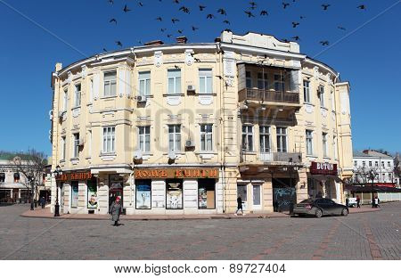 ODESSA, UKRAINE - MARCH 23, 2015: People near the building of Book House on the Grecheskaya square. The building housed the largest bookstore in city is the monument of architecture