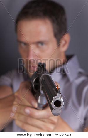 Man Pointing Gun Looks Mad